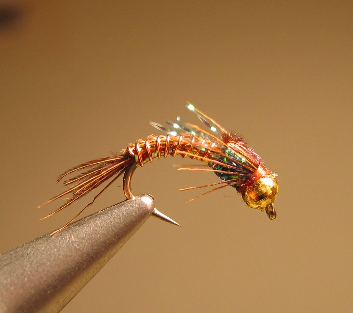 Frank s flashy fly pattern planettrout for Fly fishing tying